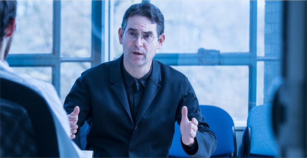 John D. Halamka, M.D. in business meeting